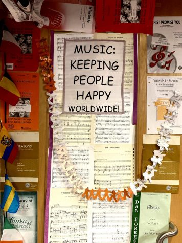 Festive decorations are put up on the choir room doors to happily welcome students in.