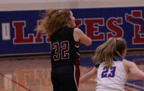 Senior Molly Volkmar looks to pass the ball off to a fellow teammate.