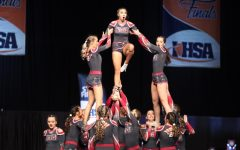 Middle flyer, Kaitlyn Bargamian hits her extended lib in the pyramid.