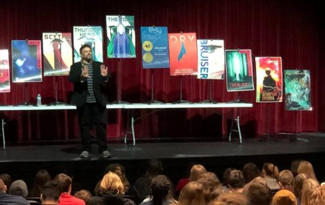 Pictured are Shusterman and his assorted works. From left to right, they are: