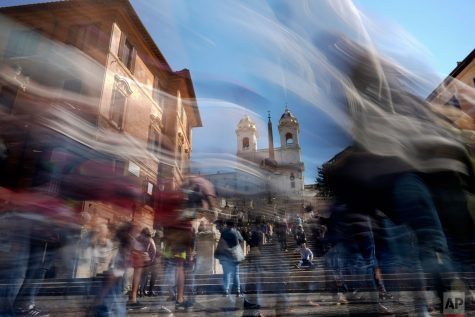 In this photo made with a long exposure, people walk by the Spanish Steps in Rome. This can resemble how life may feel when a gap year is taken, time has the potential to pass by quickly