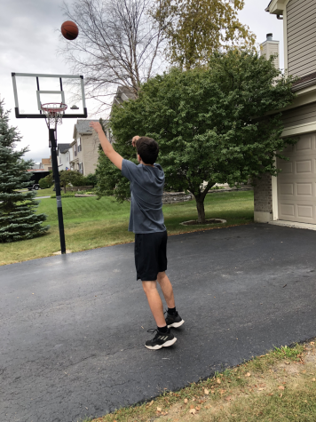 Senior Jared Wolf playing basketball in order to prepare for the possible upcoming basketball season and keep himself in good shape.