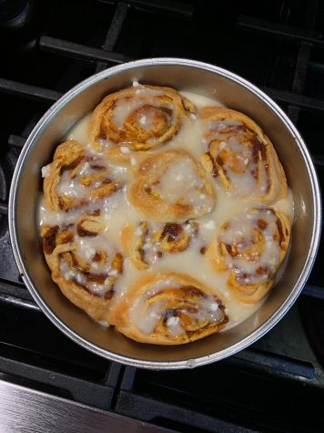 Staffer Reagan Brewer pictured a tin of freshly baked pumpkin cinnamon rolls. This pastry is a way start of the fall season with a sweet and warm pumpkin treat as the days get colder.