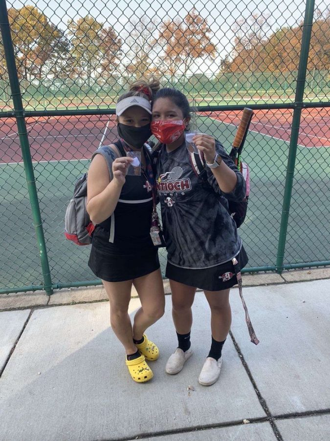 Jocelyn+Cabuyadao+and+Natalie+Labicki+after+their+last+match+at+sectionals.+After+they+beat+Grayslake+Central%2C+they+placed+3rd.