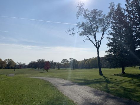 Hole 3 at Bristol Oaks Golf Club with slight overcast and some sun peeking through the clouds.