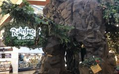 Rainforest Cafe entrance shows a large contrast between itself and the rest of the mall. Overall adding to the environment and atmosphere of the restaurant.