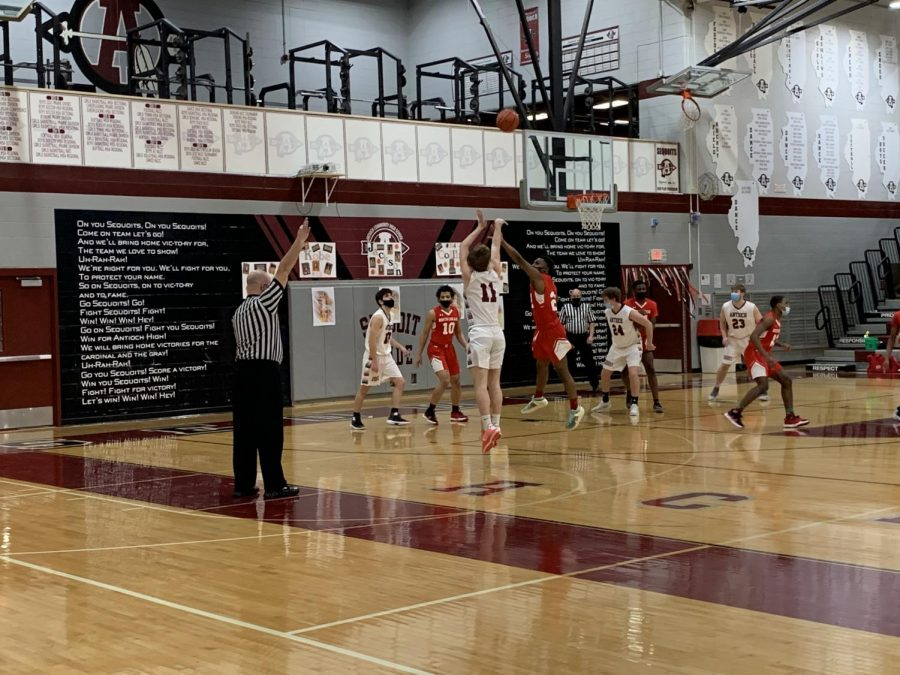 Senior Kobe Kriese Shoots a 3 expand the lead against North Chicago.