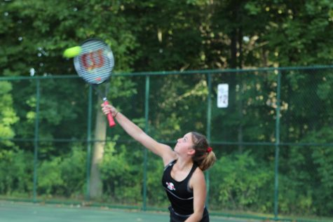 Junior Paige Wilson serves in the Sequoits dominant first match of the season.
