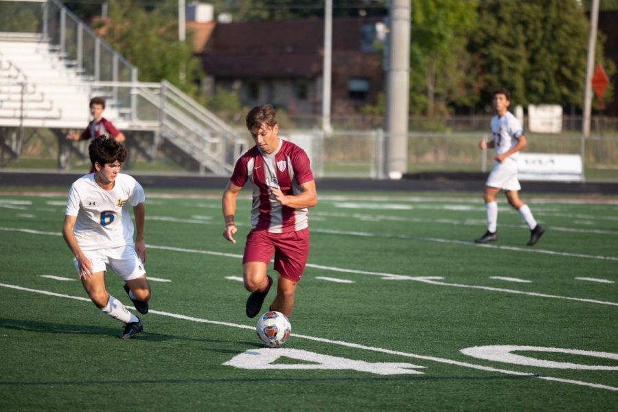 Senior Remi Ivanovas carries the ball down the field before assisting on the Sequoits only goal of the game.