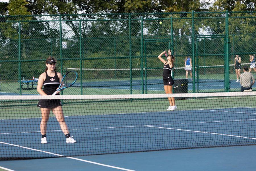 Senior Caitlynn Gsell and junior Elle Ipsen get ready to serve against Lakes.