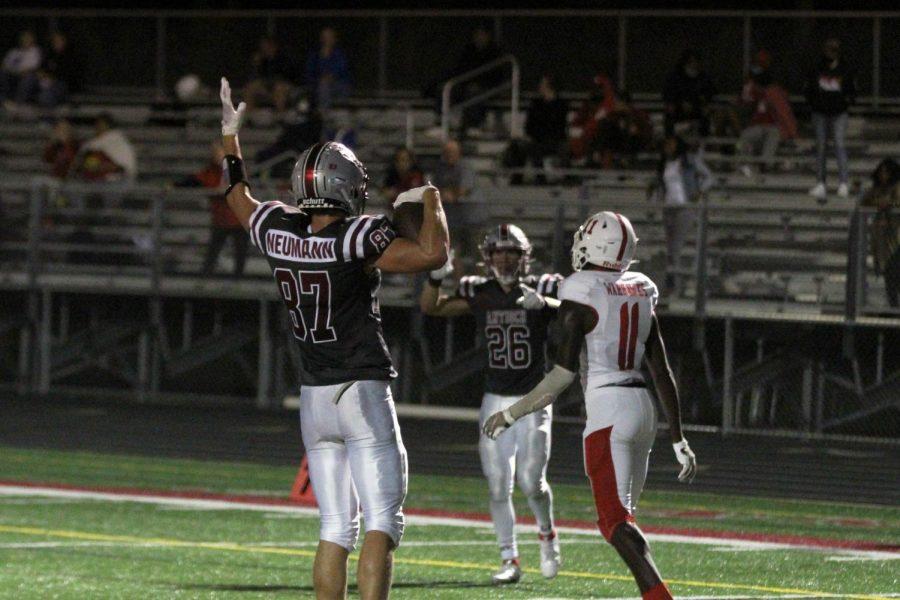 Joey Neumann celebrates after catching a touchdown pass, extending the Sequoits lead.