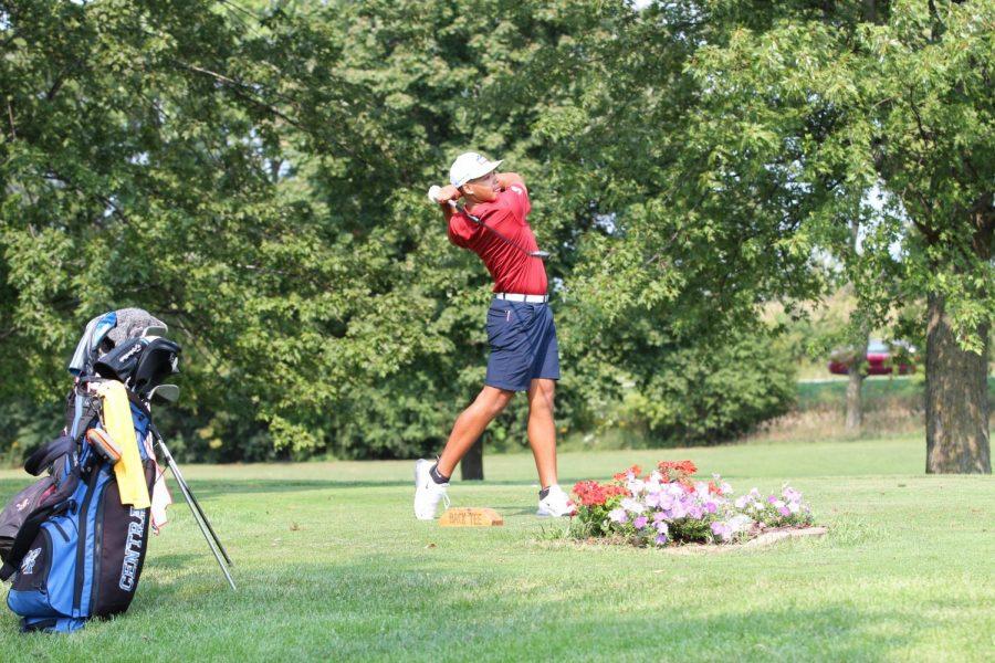 Junior Donald Barnett pars hole 14 at the invitational.