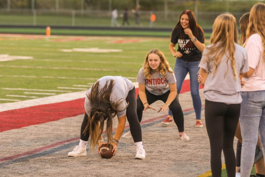 Football managers Paytin Rasmussen, Ally Stephens and McKenzie Christian show the boys how it is done.