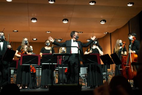 Orchestra Director Michael Riggs soaks in the applause as ACHS welcomes back band concerts