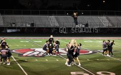 Senior cheerleader Bella Bussone flies during the guy-girl dance at the 2021 Homecoming pep assembly.