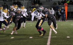 Junior Joey Neumann tackles Round Lake player in Sequoits homecoming game.